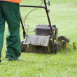Man gardener working with lawn mower — Stock Photo #1121263
