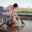 Woman in wheelchair — Stok fotoğraf