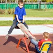 Royalty-Free Stock Photo: Children on a seesaw