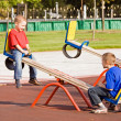 Children on a seesaw — Stock Photo