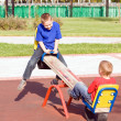 Stock Photo: Children on a seesaw