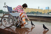 Woman in wheelchair — Stock Photo