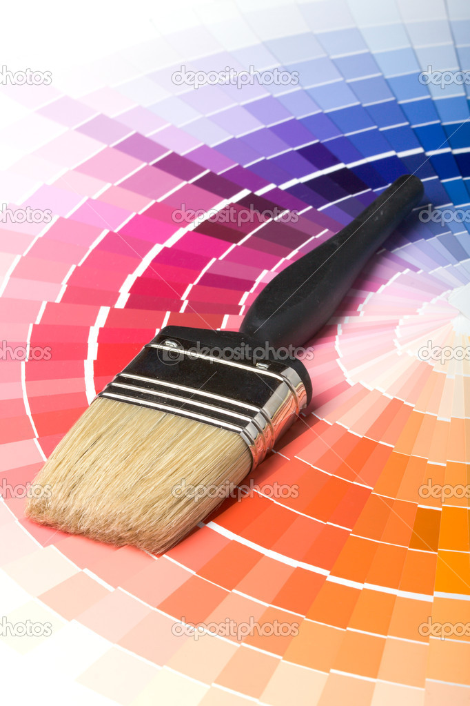 A paint brush over a wheel of colorful paint swatches. — Photo #1120692