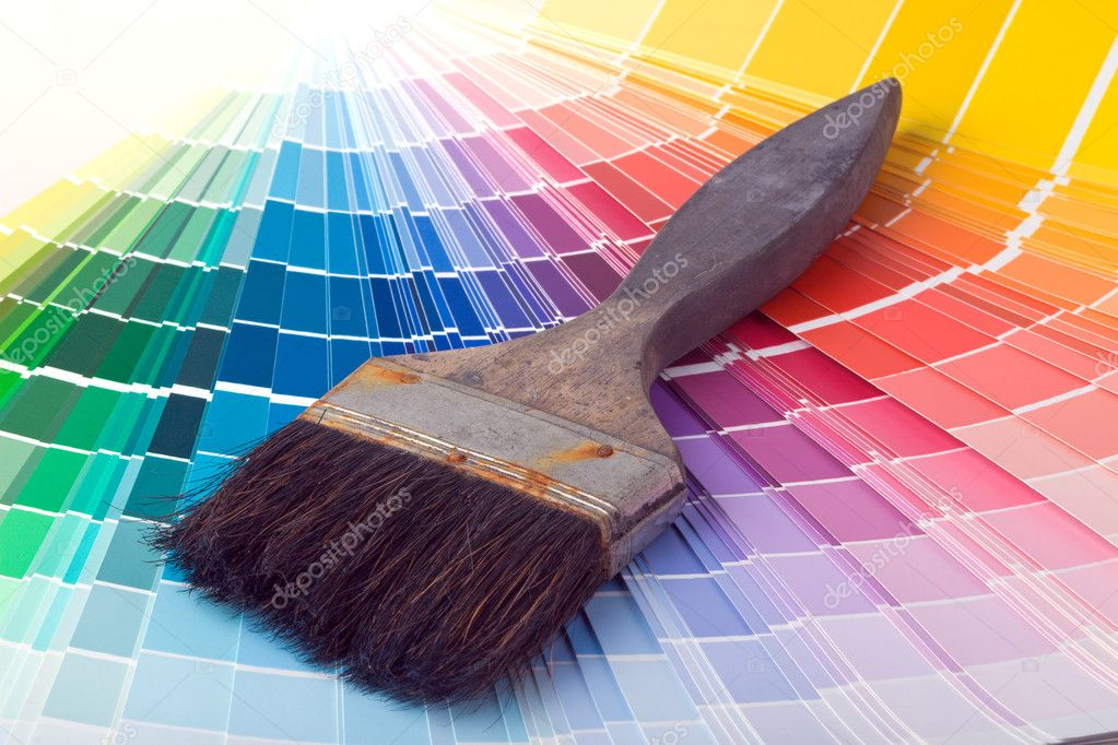 A paint brush over a wheel of colorful paint swatches. — Stock Photo #1120732