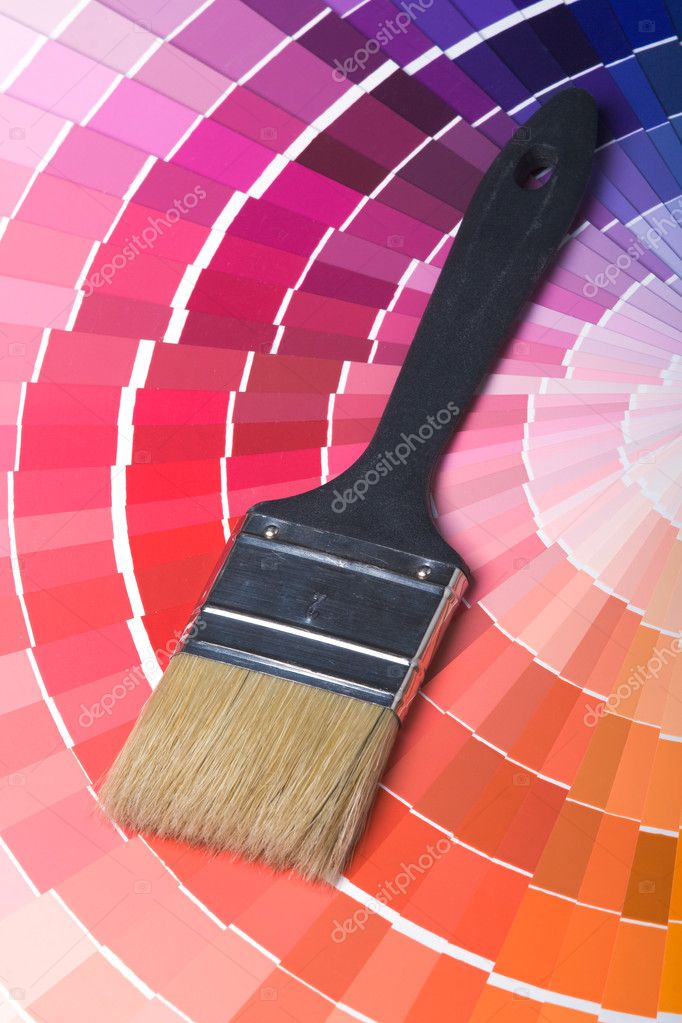 A paint brush over a wheel of colorful paint swatches. — Stock Photo #1121680
