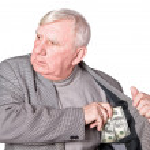 Elderly man puts money — Stock Photo