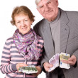 Elderly married couple with money — Stock Photo