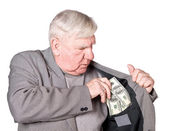 Elderly man puts money — Stock Photo
