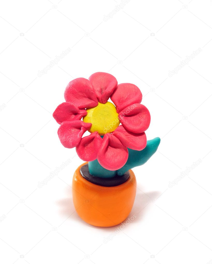 Red flower in a pot. It is made of plasticine. — Stock Photo #1175147