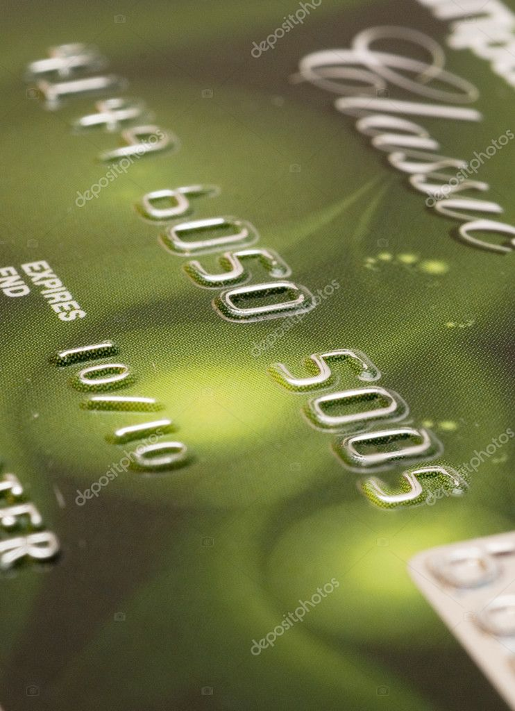 Fragment of a plastic credit card on a white background — Stock Photo #1267257