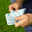 Paper money in hands — Stock Photo #1226996