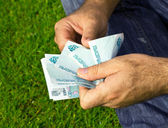 Paper money in the hands — Stock Photo