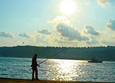 Fisherman at the sea — Stock Photo