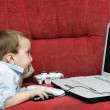 Baby with laptop — Stock Photo