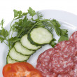 Cut green-stuffs and pieces of sausage o — Stock Photo