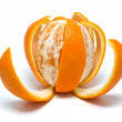 Orange with the cut skin on a white back — Stock Photo