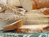 Bread and ears of wheat — Stock Photo