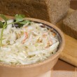 Stock Photo: Cole-slaw and bread on cook-table