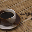 Cup with coffee and  coffee grain - Stock Photo