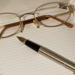 Orgaynizer, glasses and pen - Stock Photo