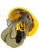 Yellow helmet, mittens, instrument for — Stock Photo