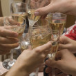 Stock Photo: Celebration. Hands holding glasses o