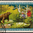 Postage stamp. it hunts on a bear — Stockfoto