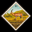 Postal stamp. Impala is a medium-sized — Stock Photo