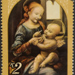 Stock Photo: Vintage stamp depicting Madonna