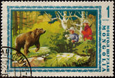 Postage stamp. it hunts on a bear — Stock Photo