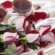 Two glasses with wine and red rose — Stock Photo #1537864