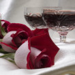 Stock Photo: Two glasses with wine and red rose