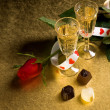 Glasses with wine and red rose — Stock Photo