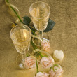 Two glass with wine and roses — Stock Photo
