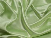 Elegant green ablaze satin background — Stock Photo