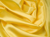 Elegant yellow ablaze satin background — Stock Photo