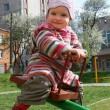 The little girl on a swing — Stock Photo #1100752