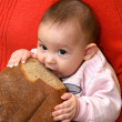Child with bread — Stock Photo #1101349