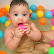 The child bathing in a bath — Stock Photo