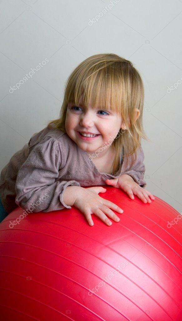 The little girl with a greater red ball — Stock Photo #1103245