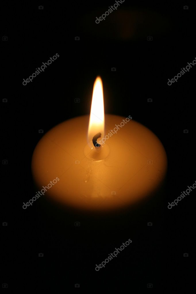 Burning candle on a dark background — Stock Photo #1279957