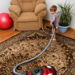 The little girl with a vacuum cleaner — Stock Photo