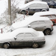Stock Photo: Cars covered in snow after snowstorm