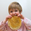 The girl with a pancake — Stock Photo #1287624