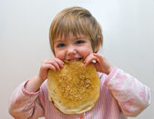 The girl with a pancake — Stock Photo