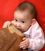 The child with bread — Stock Photo