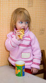 Child with a cracker — Stock Photo