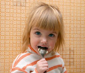 Child with the spoon — Stock Photo