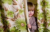 The little girl has hidden — Stock Photo