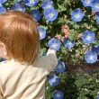 Child with flowers — Stock Photo #1303326